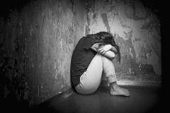 sad-young-woman-girl-sitting-floor-corner-room-66390371